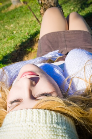 beautiful woman lying on the grass relaxing  photo