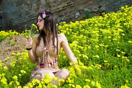 Young hippie girl smelling flowers