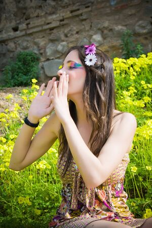 beautiful hippie girl calling someone