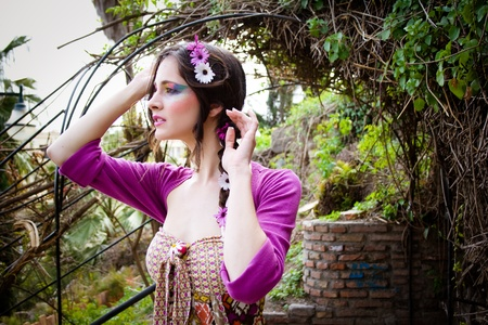Beautiful hippie girl, watching from afar  Stock Photo