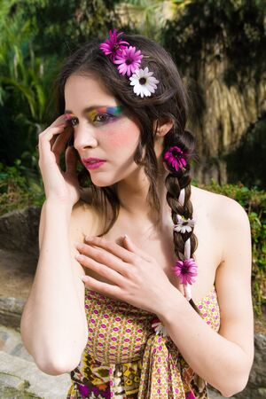 portrait of beautiful hippie girl with a look of shyness  photo
