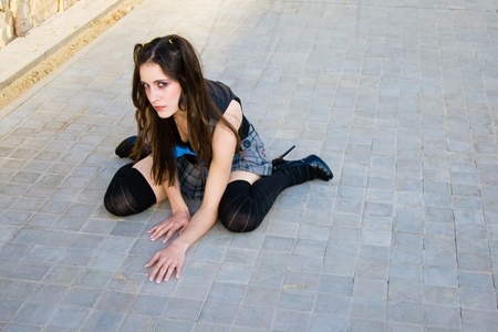 Young schoolgirl on the floor