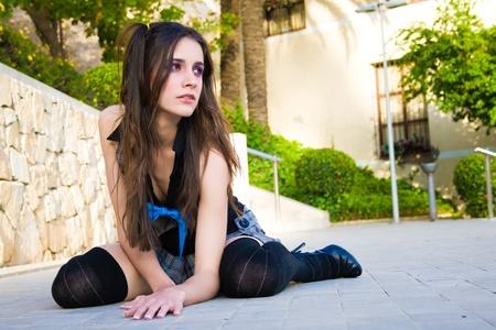 university fountain: Young schoolgirl on the floor
