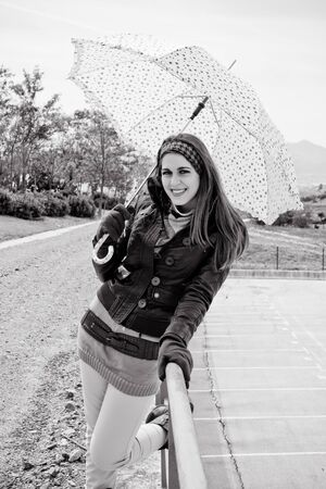 Young girl walking with her umbrella  photo