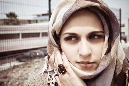 beautiful young woman with her veil around her face  photo