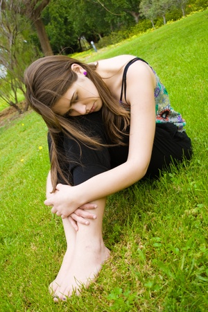 barefoot teens: young hippie girl in the field
