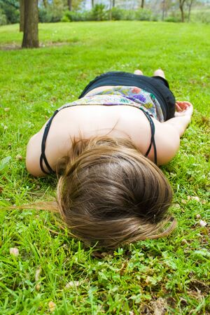 laying on back: young hippie girl in the field