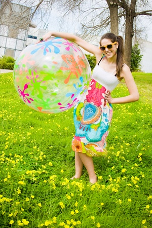 hippy girl with her beautiful summer ball and his sunglasses  photo