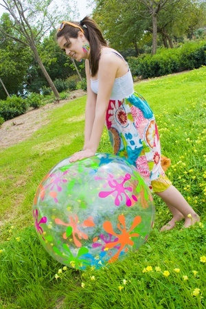 hippie girl and beautiful with its huge ball of drawings in the field