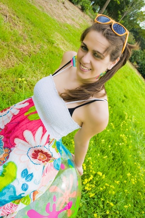 hippie girl sitting in her beautiful colored ball and facing the camera
