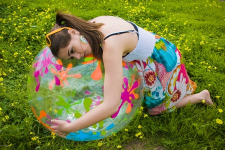 young hippie girl hugging her summer ball  Stock Photo