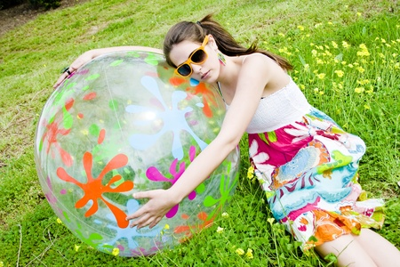 hippy girl with her beautiful summer ball and his sunglasses