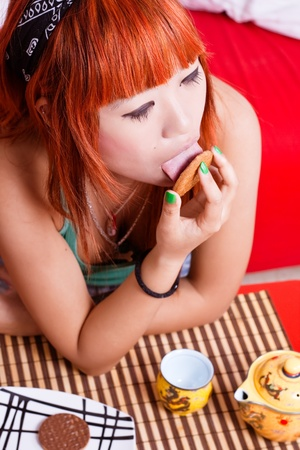 Japanese girl picnicking a chocolate chip cookie  Stock Photo - 12034556
