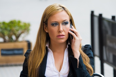 Business beautiful girl sitting, talking to her mobile