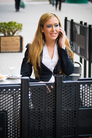 young girl business, talking on the phone very happy Stock Photo - 12034472