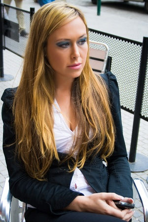 Young female executive, sitting in a bar waiting for someone