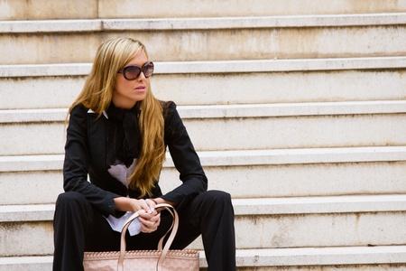 Executive beautiful woman, waiting at the stairs