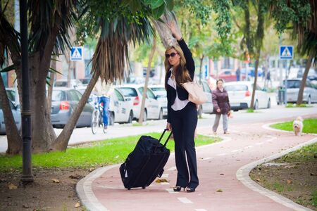 young businesswoman waving in the distance
