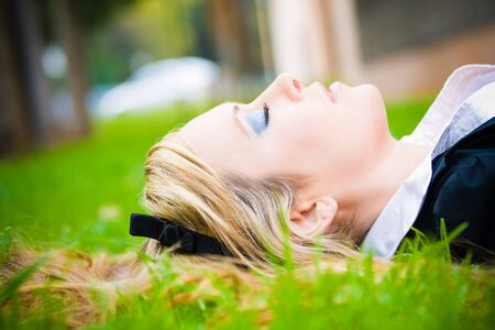 Portrait of woman sleeping in the grass Executive