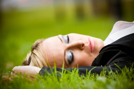 portrait of young businesswoman sleeping