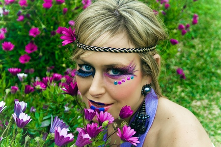 Portrait of beautiful woman with fantasy makeup.