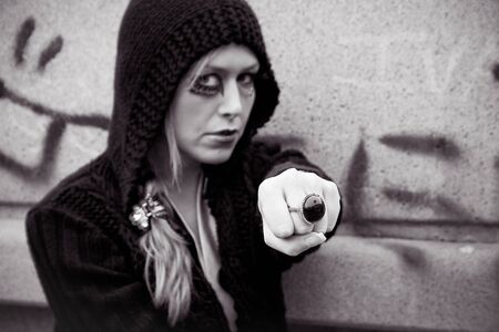 portrait of young blond woman in black and white showing his ring