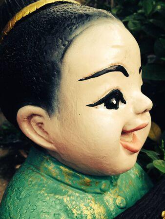 doll: Ceramic doll in garden