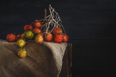 darkwood: Red Rambutans on the dark wood