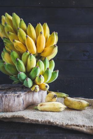 Yellow Bananas on the dark wood