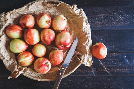darkwood: Red Peaches on the dark wood