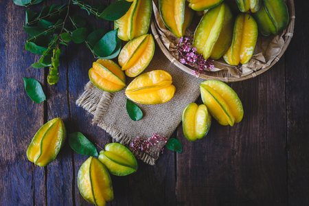 darkwood: Star fruits on the old wood Stock Photo
