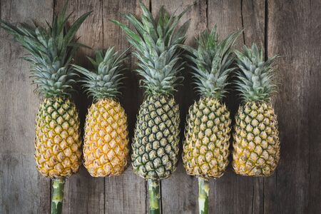 Fresh pineapples on the old wood