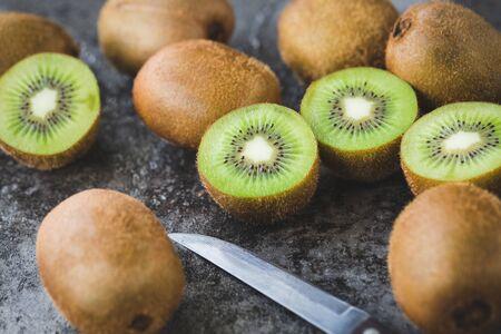 Fresh kiwi slices on the dark background Banco de Imagens