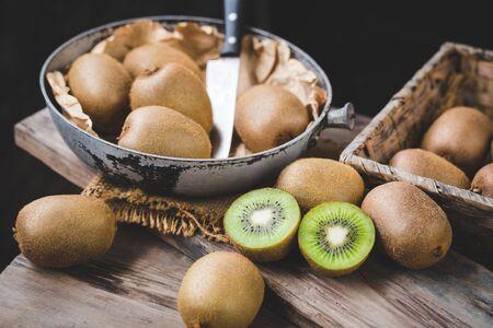 Fresh kiwi  on the old wood Banco de Imagens