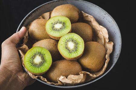 Fresh kiwi on thedark background