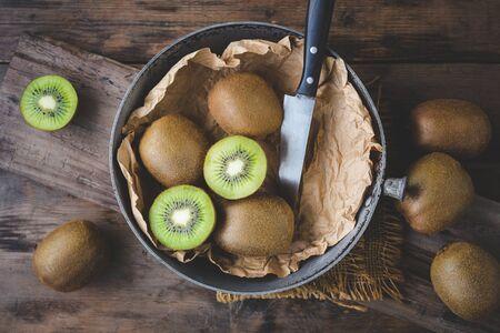 Fresh kiwi on the old wood