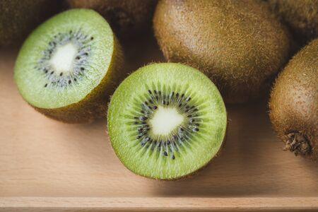 Fresh kiwi slices on the tray wood Banco de Imagens