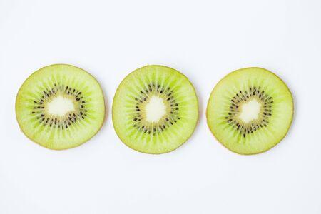 Fresh kiwi slice on the white background Banco de Imagens