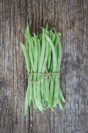 Fresh French beans-Green beans on the old wood background