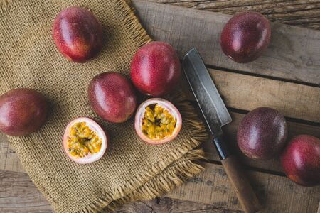 Fresh passion fruits on the dark background