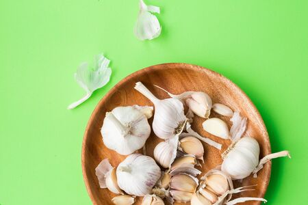 Garlic bulb-Garlic clove on green background