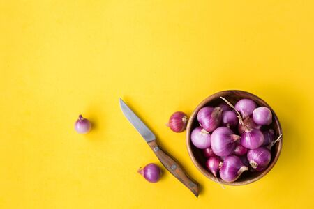 Fresh shallots on the yellow background