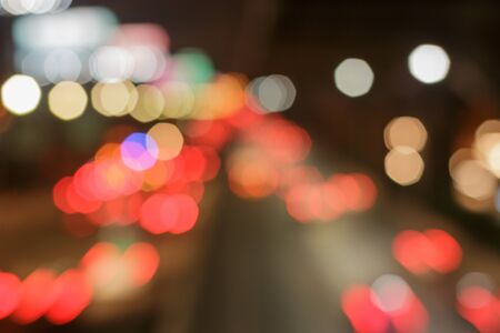 car lights: Bokeh caused by car lights. Stock Photo