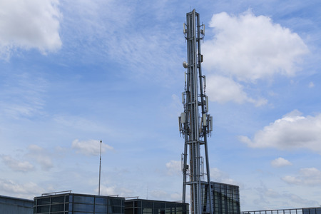 transmit: Telecommunication tower with a sunlight in the morning. Used to transmit radio network.