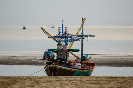 The Boat on the beach at Krabi province, Thailand  This one is the boat of poor fisherman because it very small for fishery for live  photo