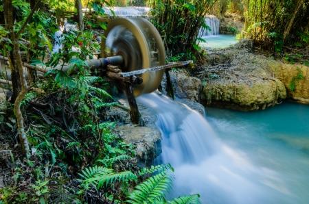 water turbine: Kuang si waterfall or Tad Kwangsi with water turbine, it is depend at Luangprabang, Laos   Tad  mean  Waterfall