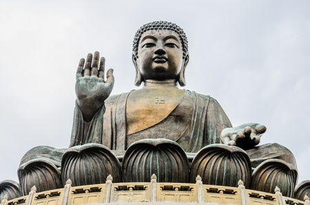 Tian Tan Buddha, also known as the Big Buddha, is a large bronze statue of a Buddha, completed in 1993, high 34 meter, weight 250 ton  and located at Po Lin monastery, Ngong Ping, Lantau Island, in Hong Kong  photo