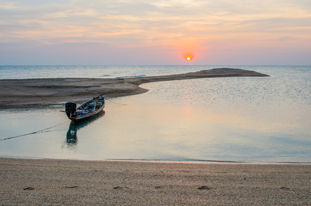 long tailed boat: Long-Tailed Boat is cast anchor on the beach with sunset.