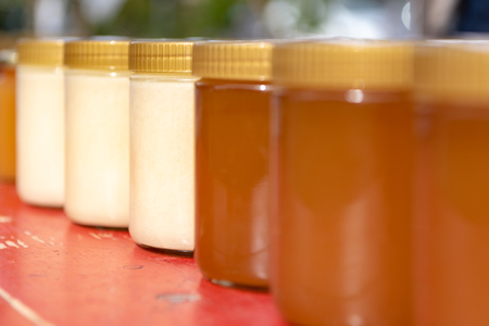 Fragrant different varieties of bees  honey  bottled in small jars