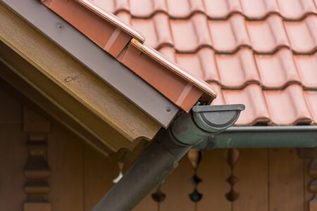 Gutter made of copper sheet. Gutter construction with down-pipe